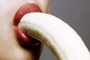 Woman-eating-banana-463472